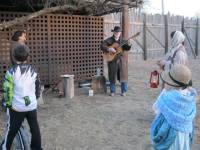Man with guitar singing outside the old jail