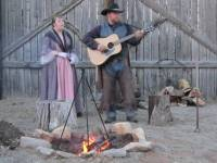 Young man and woman singing with guitar