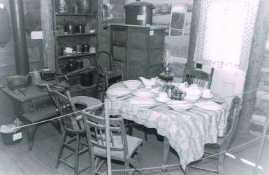 Kitchen of log cabin in 1961